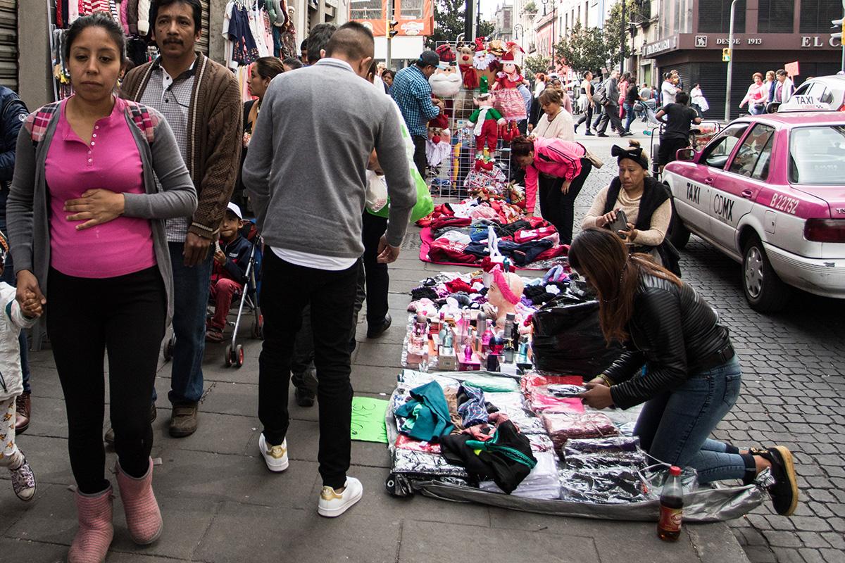 Economía informal, comerciantes, ambulantes, empleo,