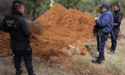 Albañiles encuentran 11 cadáveres en Michoacán
