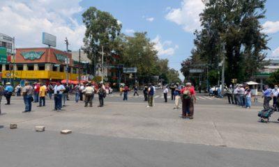 Trabajadores de la ex Ruta Cien bloquean Insurgentes y Eje 1 Norte